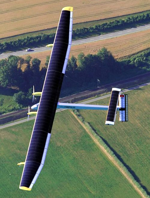 Solar Impulse's Chief Executive Officer and pilot Andre Borschberg flies in the solar-powered HB-SIA prototype airplane during its first successful night flight attempt at Payerne airport.
