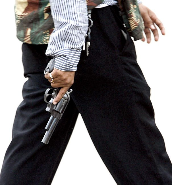 A member of India's anti-terror squad carries a gun.