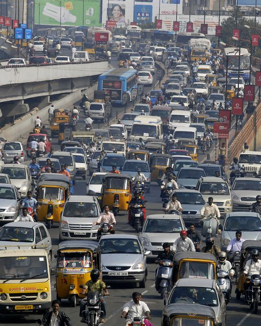 Vehicles move slowly during morning rush hour in the southern Indian city of Hyderabad.