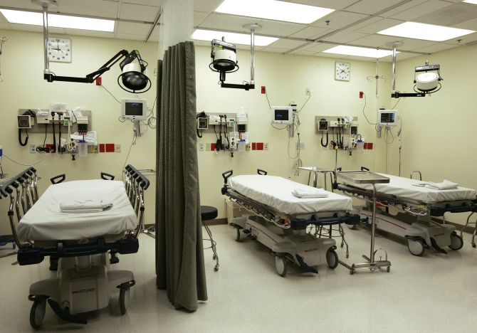 Beds lie empty in the emergency room of a hospital.
