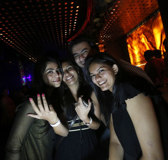 Malini Agarwal (C), blogger-in-chief of missmalini.com, poses for a picture with her friends at the Ren by China Garden nightclub in Mumbai.