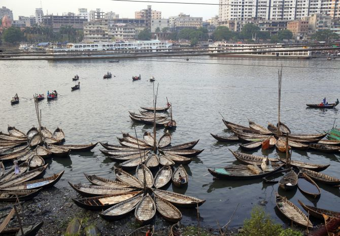 Boats are seen anchored by the river Buriganga, on the outskirts of Dhaka.
