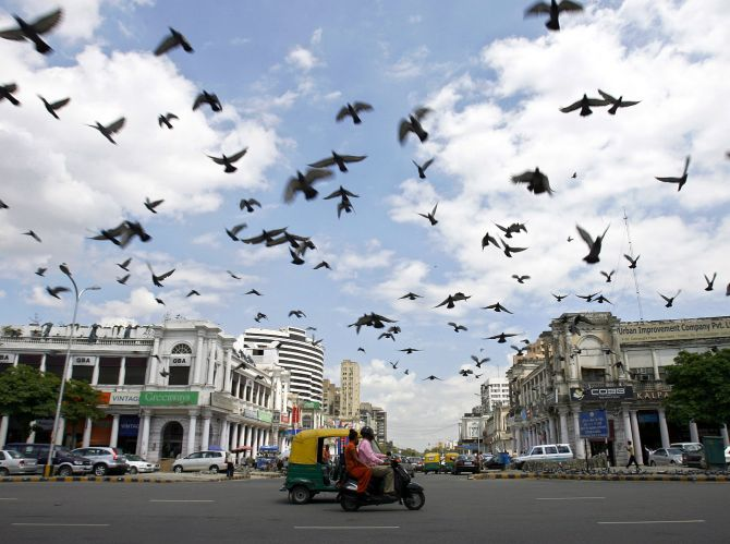 Pigeons fly as clouds gather over New Delhi's Connaught Place.