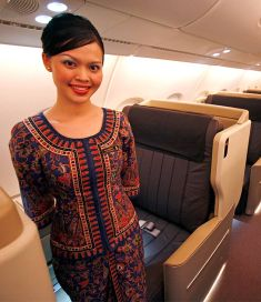A stewardess posing for a photo in the business class cabin Airbus A380 superjumbo after it landed in Singapore.