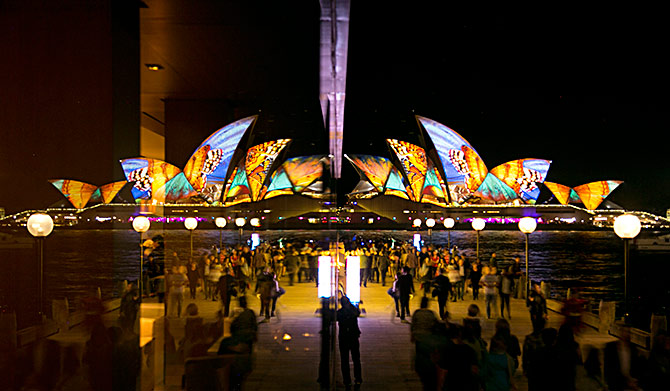 An image of butterflies is projected onto the sails of the Sydney Opera House, reflected in a hotel window on the opening night of the Vivid Sydney light and music festival.