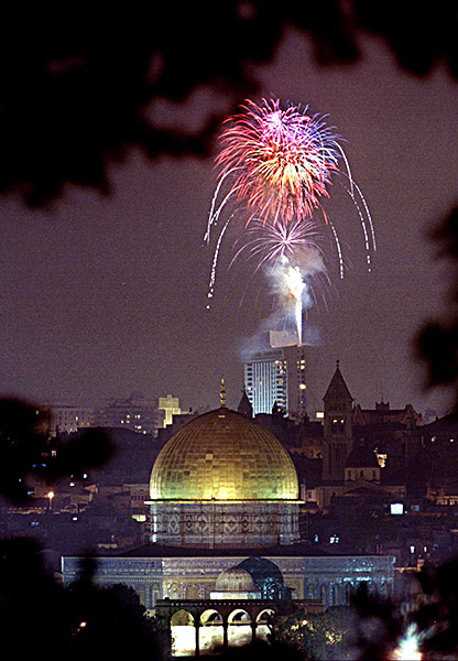 Fireworks set off from the roof of a Jerusalem hotel light up the sky over the Dome of the Rock in the Old City.