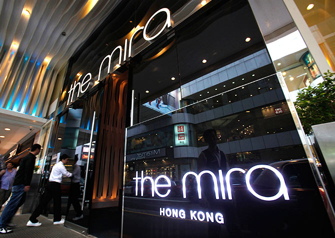 Visitors walk into The Mira Hotel, where 29-year-old former CIA employee Edward Snowden was reported to have checked out in Hong Kong.