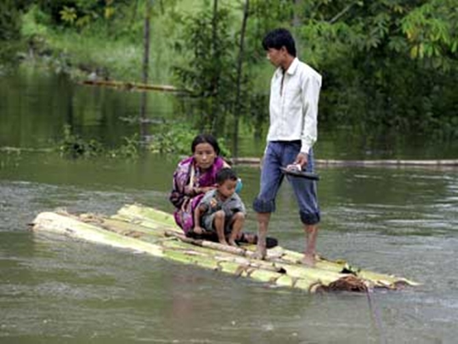 Villagers move from a flood-hit village in Arunachal Pradesh.