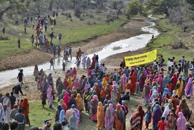 Villagers walk towards the Mahan forest during a protest against a coal mining project in Singrauli district in Madhya Pradesh.