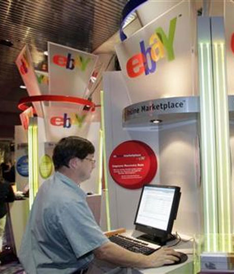 A customer uses an eBay kiosk to check on an item he has for sale.