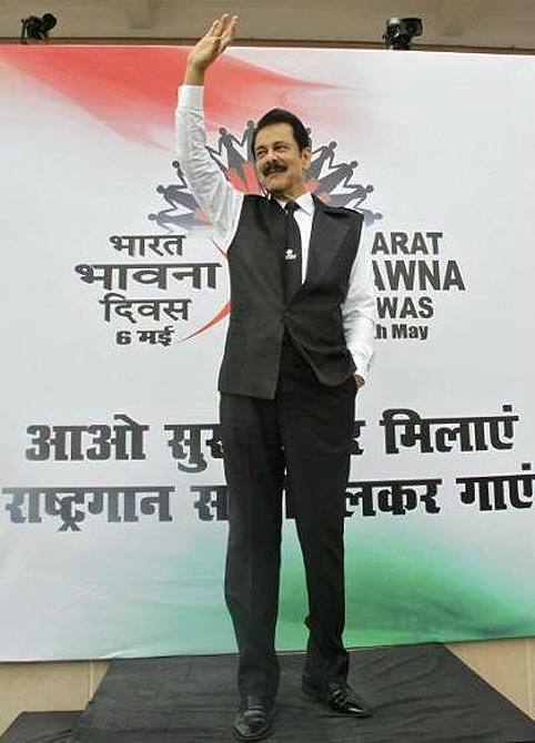 Sahara Group Chairman Subrata Roy waves at his employees before they sing the Indian national anthem in the northern Indian city of Lucknow.