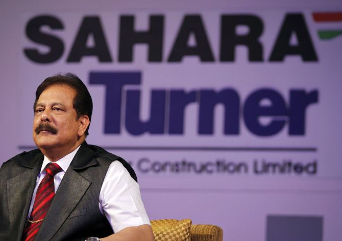 Sahara Group Chairman Subrata Roy listens to a question during a news conference in Mumbai.