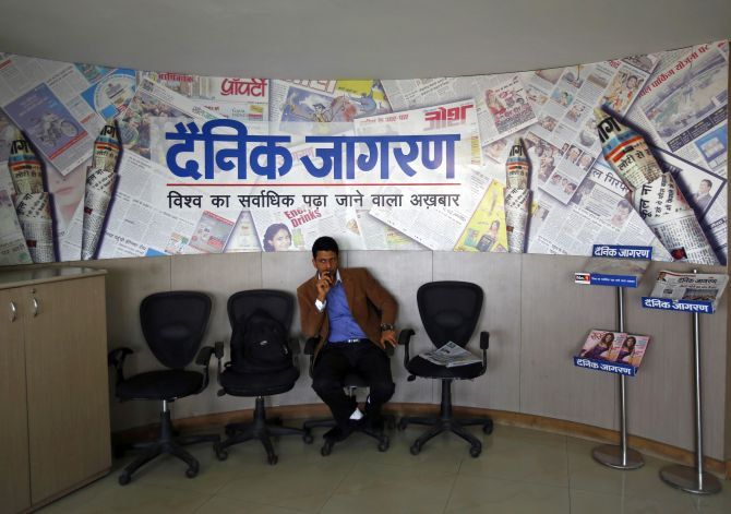 A visitor waits at the reception area of the Dainik Jagran newspaper's office in Noida.