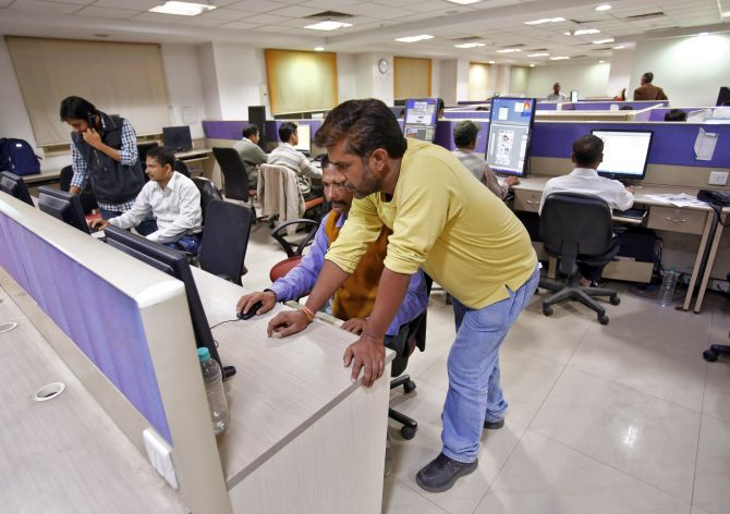 Employees work inside the office of Dainik Jagran newspaper in Noida.