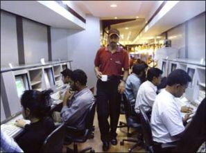 Employees of a corporate firm busy at their workstations