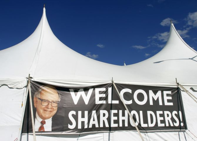 A sign featuring a photo of Chairman Warren Buffett welcomes Berkshire Hathaway shareholders to a picnic during the BH annual meeting in Omaha, Nebraska.
