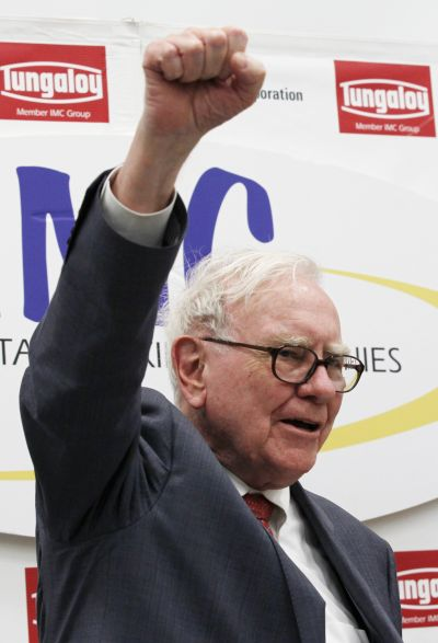 Berkshire Hathaway Chairman Warren Buffett shouts the slogan Never give up, Iwaki in Japanese, in response to a request from a local television reporter.