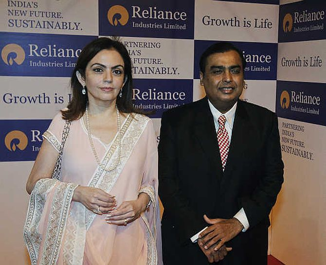 RIL chairman Mukesh Ambani with his wife Nita Ambani.at the company's AGM.