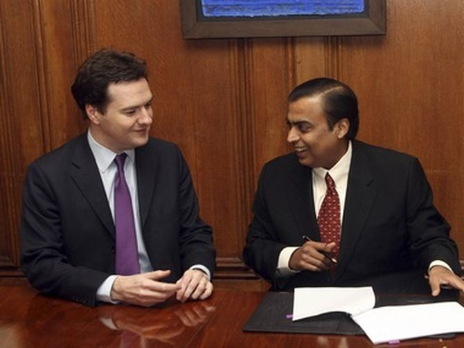 Mukesh Ambani after signing an agreement to sell stake in 21 oil blocks  to BP in August 2011.