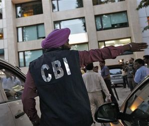 A CBI official outside the New Delhi office of the Abhijeet Group, which owns Jas Infrastructure, after conducting a raid on September 4, 2012.