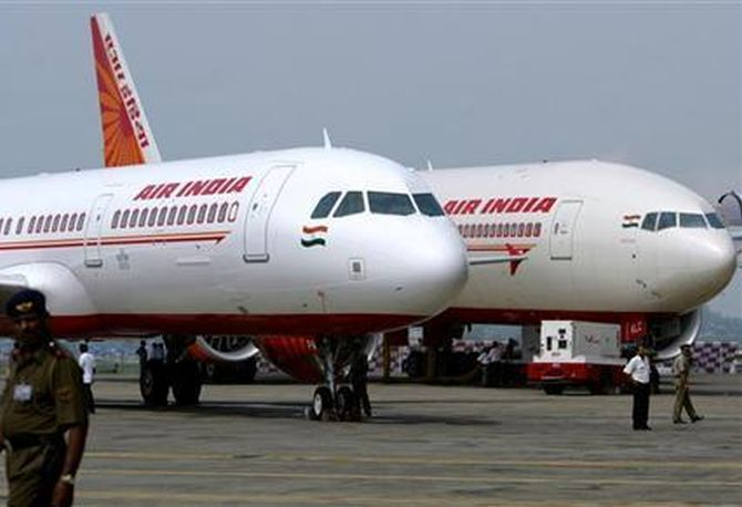 Air India's newly acquired Airbus A321 (L) and Boeing 777-200 LR aircrafts are on display at the tarmac of Mumbai airport.