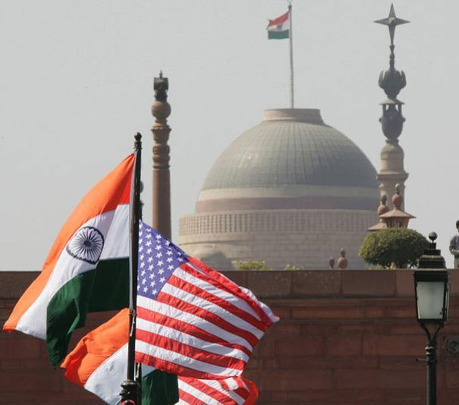 Indian and US national flags flutter in front of the Presidential Palace in New Delhi.