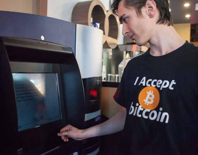 Gabriel Scheare uses the world's first bitcoin ATM.