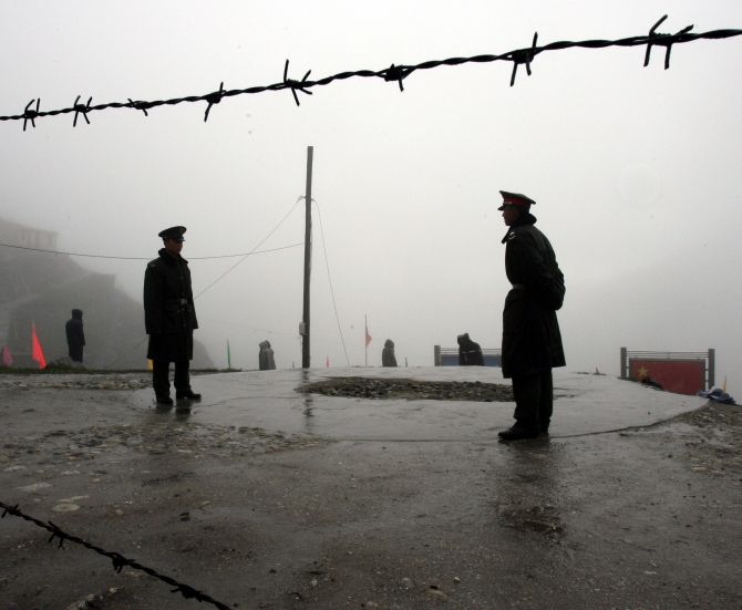 Chinese guards stand near the India-China border at Nathula, Sikkim