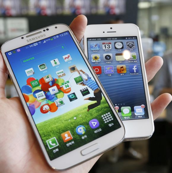 Samsung Electronics' Galaxy S4 (L) and Apple's iPhone 5 are seen in this picture illustration.