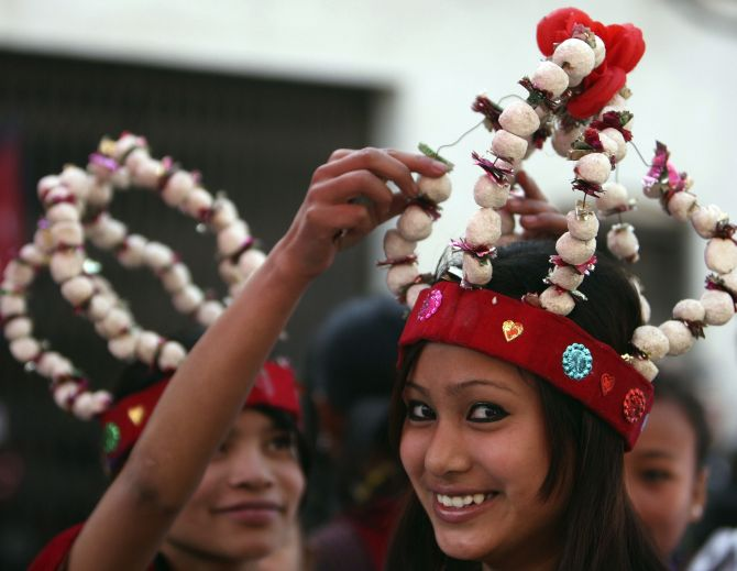 Gurung girls wearing traditional dresses take part in a New Year parade in Kathmandu.