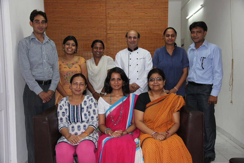 Gauri Singh (front row, centre) with her team at The Maids' Company.