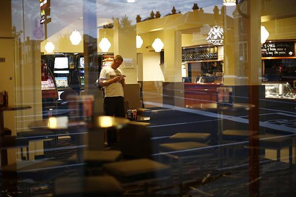 A customer is seen through the window of a pub in Geelong.