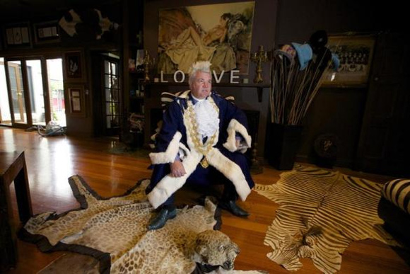 ewly elected Geelong Mayor, Darryn Lyons poses for a photograph in his mayoral robes in the living room of his home in Geelong.