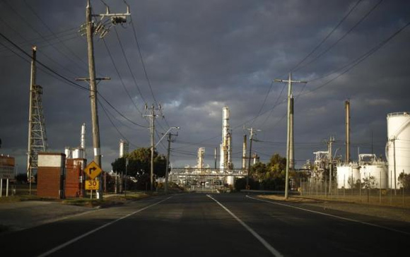 The road leading to the Shell Oil Refinery is seen at sunset in Geelong.