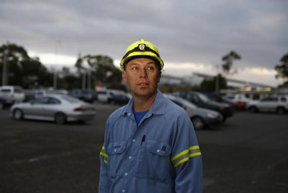 Alcoa aluminium smelter worker Adam Oates, 42, is pictured at his workplace in Point Henry.
