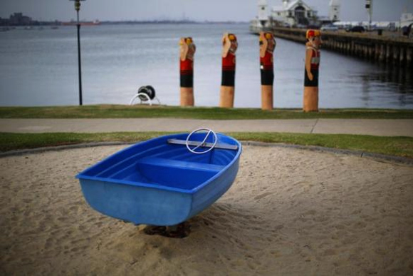 A children's playground ride in the shape of a boat is seen along Geelong's waterfront.