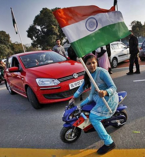 A woman holds an Indian flag