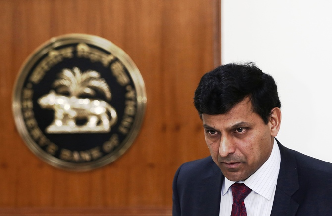 Reserve Bank of India (RBI) Governor Raghuram Rajan attends a joint news conference with India's Finance Minister Palaniappan Chidambaram (not pictured) in New Delhi March 7, 2014.