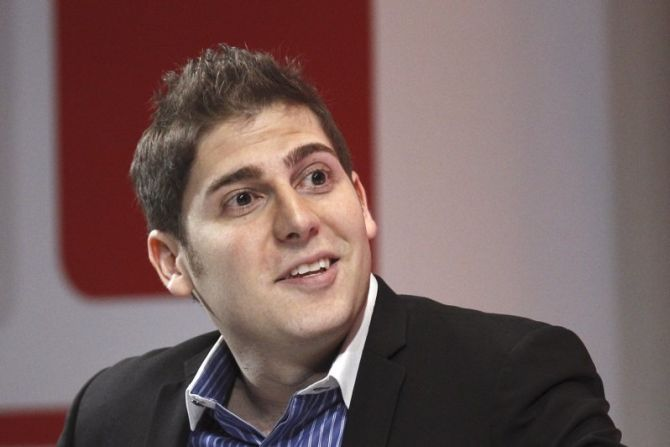 Facebook co-founder Eduardo Saverin speaks at a conference.