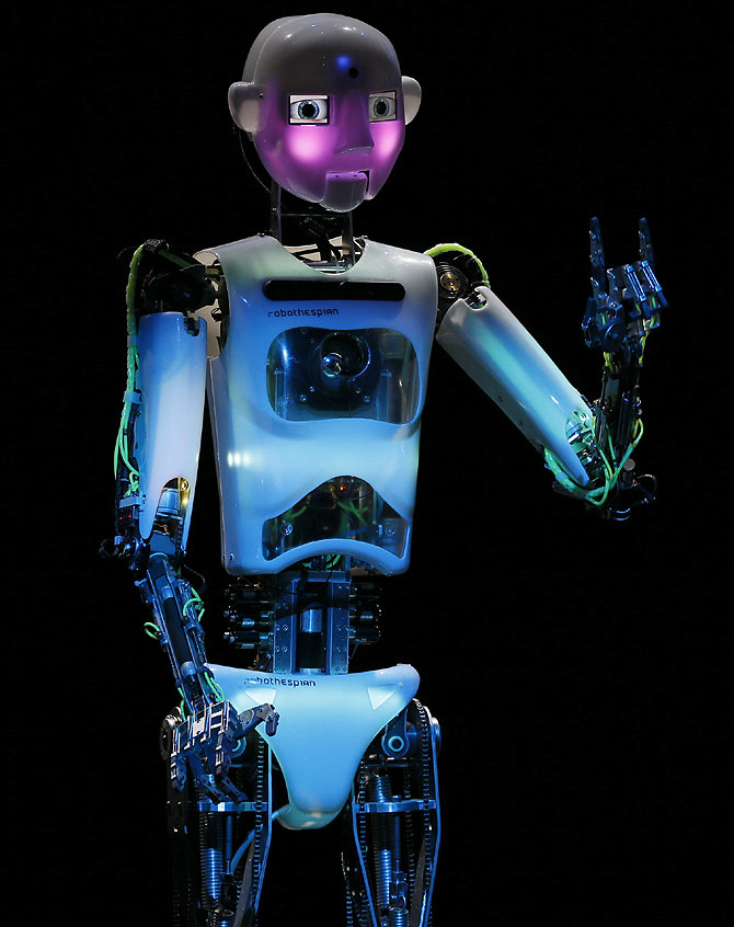 Humanoid robot of British company RoboThespian 'blushes' during the opening ceremony of the Hanover technology fair CeBIT in Germany.
