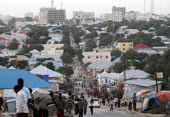 People walk along a street in Mogadishu.