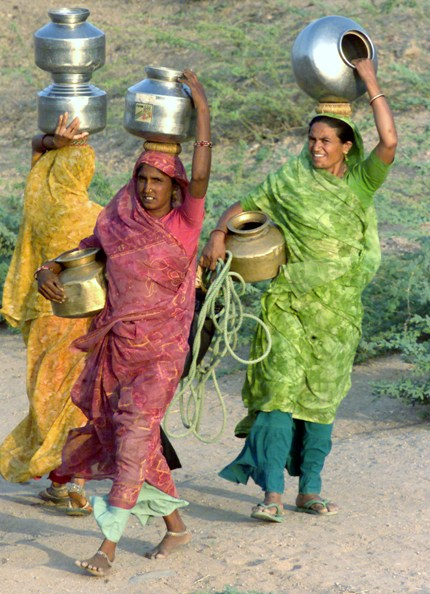 Villagers carry vessels containing drinking water in the village of Kundaliya in the drought affected Gujarat.