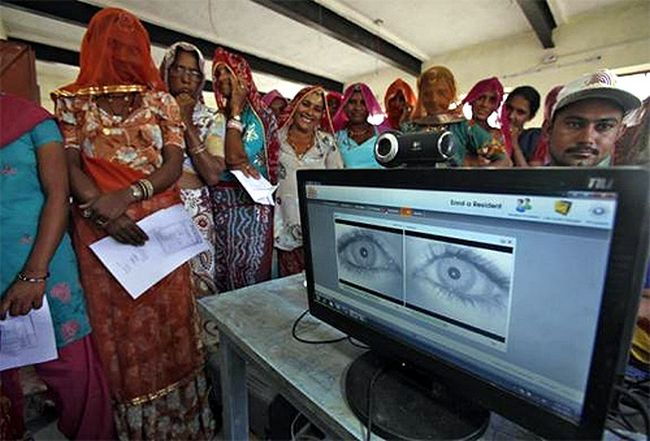 Village women stand in a queue to get themselves enrolled for the Unique Identification database system at Merta district in Rajasthan.