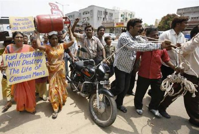 Citizens protest after the govt capped subsidy on LPG cylinders.