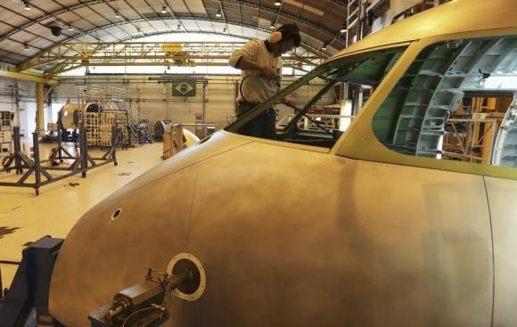 An employee works on the jet assembly line at the Embraer headquarters in Sao Jose dos Campos, 100 km from Sao Paulo May 14 2013.