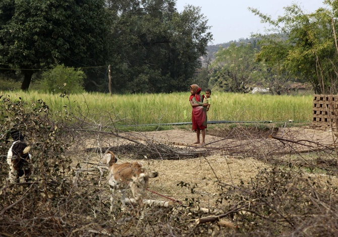 A young girl holds an infant in Amelia village in Singrauli district in Madhya Pradesh.