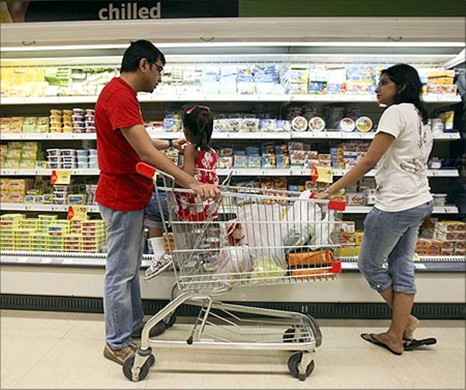 People shop in the chilled foods section of a Reliance Fresh supermarket in Mumbai.