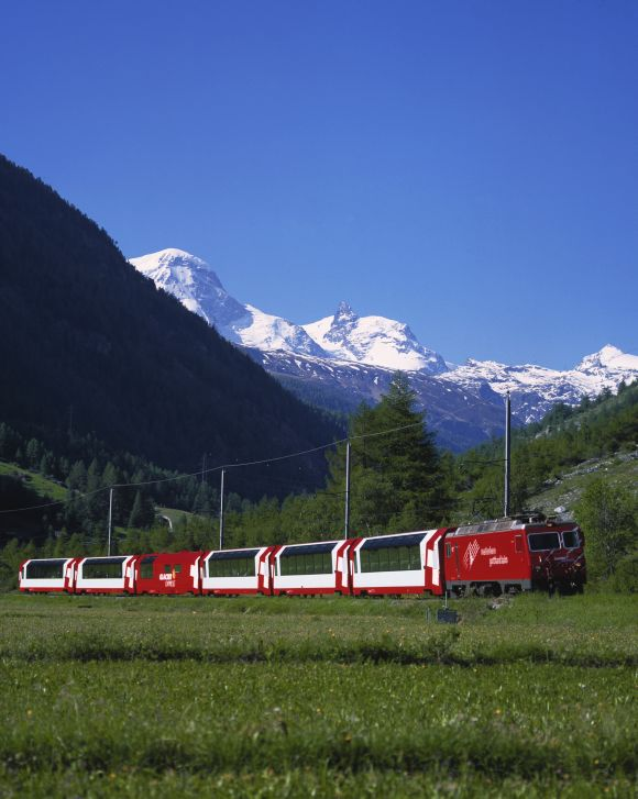 Glacier Express travelling in front of 'Breithorn' and 'Little Matterhorn' mountains.