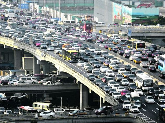 Rush-hour traffic in Beijing: As public dissatisfaction rises in China over the country's smoggy skies, cities such as Beijing and Tianjin have put limits on car purchases.