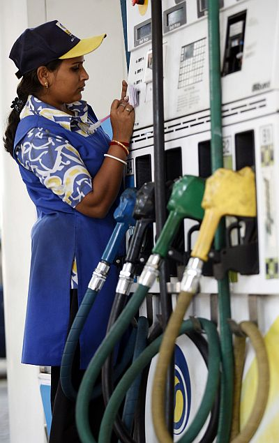A woman employee works at a petrol pump in the eastern Indian city of Kolkata.